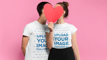 Valentine's Day T-Shirt Mockup of a Couple Hiding Behind a Paper Heart 25418