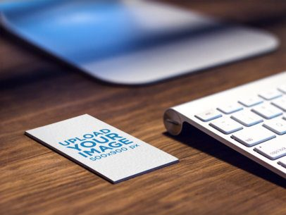 Mockup of a Business Card Lying on Top of a Desk at a Creative Office a6133