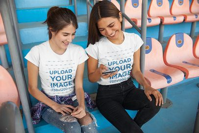 Tee Mockup Featuring Two Women at a Stadium 25220