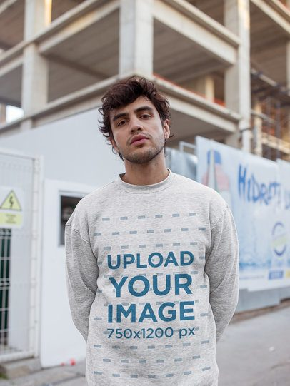 Heather Sweatshirt Mockup of a Serious Man Outside a Building Under Construction 18185