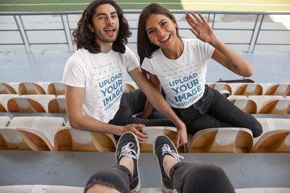 T-Shirt Mockup of a Happy Couple at a Stadium 25235