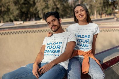 Mockup of a Cute Couple Wearing T-Shirts at an Urban Skate Park 25232
