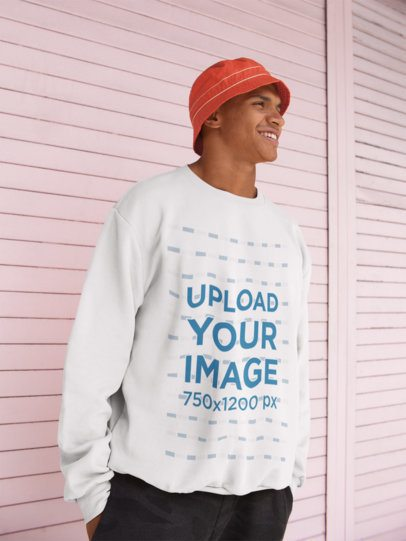 Crewneck Sweatshirt Mockup of a Happy Man Standing Against a Pink Metal Wall 21060
