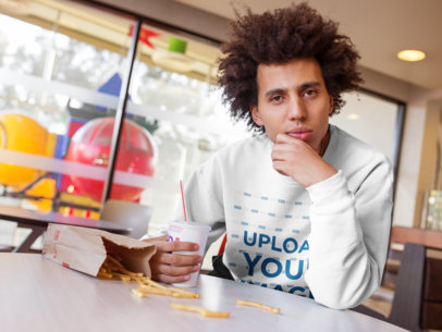 Sweatshirt Mockup of a Man with an Afro Eating Some Fries 18340