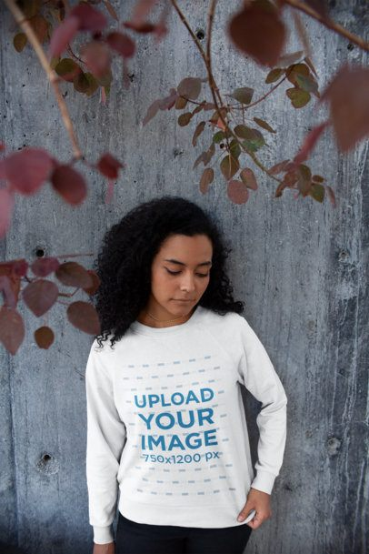 Mockup of a Serious Young Woman Wearing a Sweatshirt Outdoors 18259