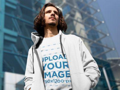 Mockup of a Serious Man Wearing a Sweatshirt Outside a Modern Building 18064