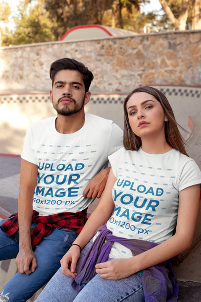 Mockup of a Couple Wearing Tees at a Skate Park 25237