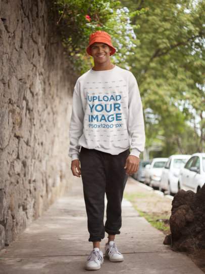 Crewneck Sweater Mockup Featuring a Happy Man Walking Down the Street 21067