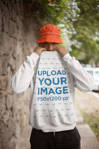 Sweatshirt Mockup of a Man Covering his Face by a Stone Wall 21068