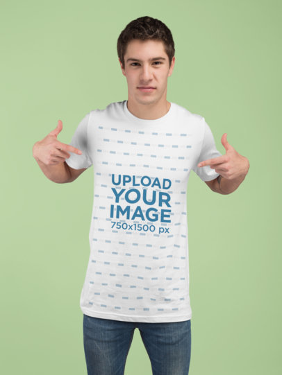 Mockup of a Man Showing Off His Tee in a Studio 25286