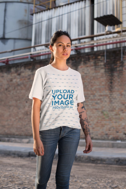 Mockup of a Woman Wearing a Unisex T-Shirt in an Industrial Zone 25277