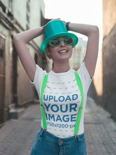 T-Shirt Mockup of a Smiling Woman Celebrating St. Patrick's with Green Glasses 19564
