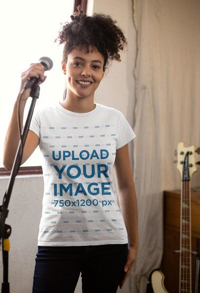 T-Shirt Mockup of a Girl with a Kinky Curly Ponytail Holding a Microphone 24280