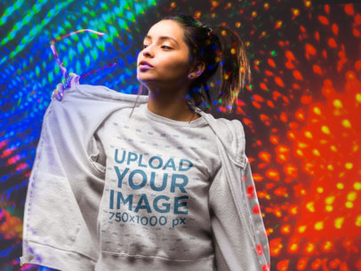 Sweatshirt Mockup of a Cool Girl Surrounded by Colorful Lights 18757