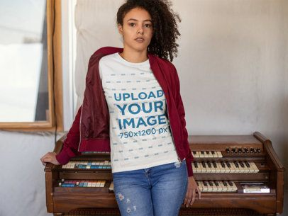T-Shirt Mockup of a Curly Haired Girl Leaning on an Old Piano 24286