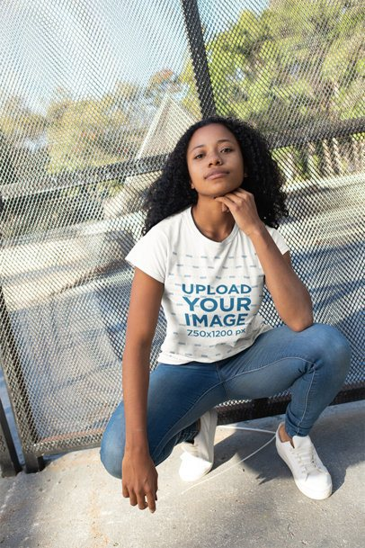 Tshirt Mockup of a Girl with Curly Hair Crouching 24095