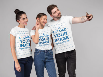 T-Shirt Mockup of Three Friends Taking a Selfie in a Studio 25698