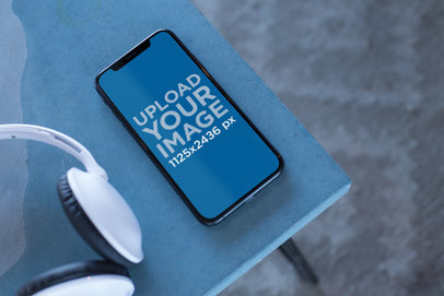 Podcast Mockup Featuring an iPhone X on a Table 24795