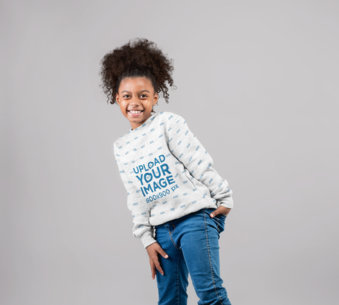 Mockup of a Happy Girl Wearing a Sublimated Sweater in a Photo Studio 24852