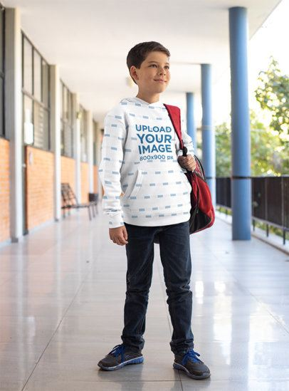 Mockup of a Kid Wearing a Sublimated Pullover Hoodie at School 24838