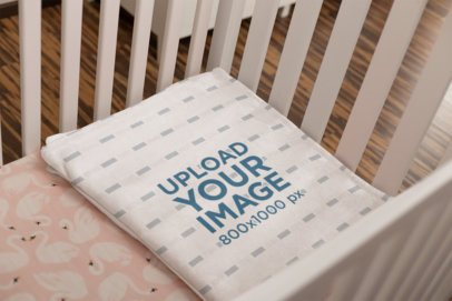 Mockup of a Folded Throw Blanket on a Girl's Cradle 24696