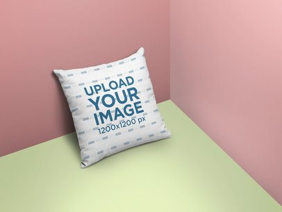 Mockup of a Square Pillow Lying on a Room's Corner 25155