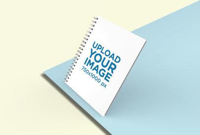 Render Mockup of Spiral Notebook over Multicolored Cardboards 26107
