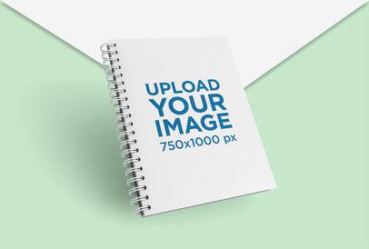 Render Mockup of Spiral Notebook Floating over Bicolor Cardboards 26109