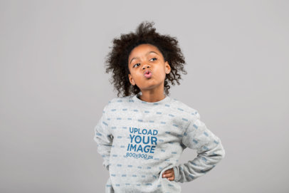 Mockup of a Little Girl Blowing a Kiss Wearing a Heathered Crewneck Sweatshirt  at a Studio 24856