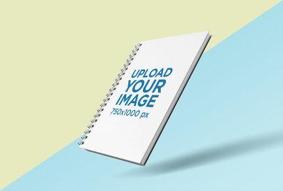 Render Mockup of Spiral Notebook Floating over a Bicolor Surface 26112