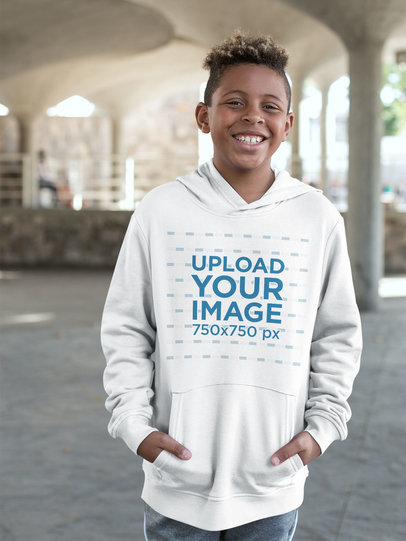 Pullover Hoodie Mockup Featuring a Kid Smiling in Urban Outdoors 24937