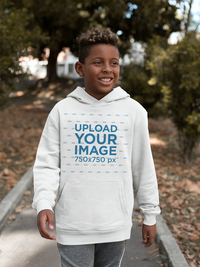 Mockup of a Kid Walking Outdoors with a Pullover Hoodie 24940