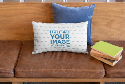 Pillow Mockup Featuring Books over a Wooden Sofa with Leather Cushions 25908