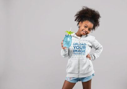 Mockup of a Little Girl Wearing Full Zip Hoodie While Holding a Jar 24862