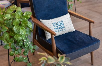 Mockup of a Pillow on an Elegant Wooden Chair 25910