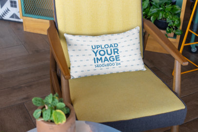Mockup of a Pillow Resting on a Modern Wooden Chair 25916