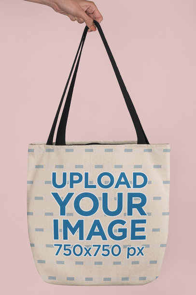 Mockup of a Hand Holding a Tote Bag in a Studio  24831