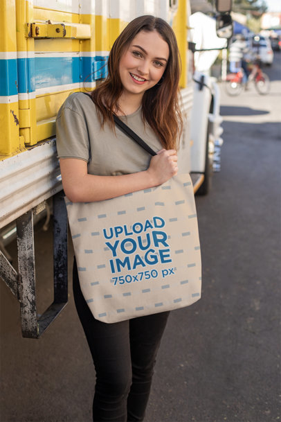 Tote Bag Mockup of a Woman Posing in the Street Beside a Truck 24875