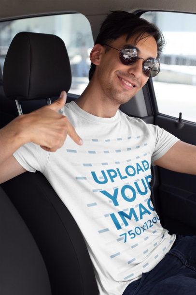 Mockup of a Smiling Driver Showing off His T-Shirt 26221