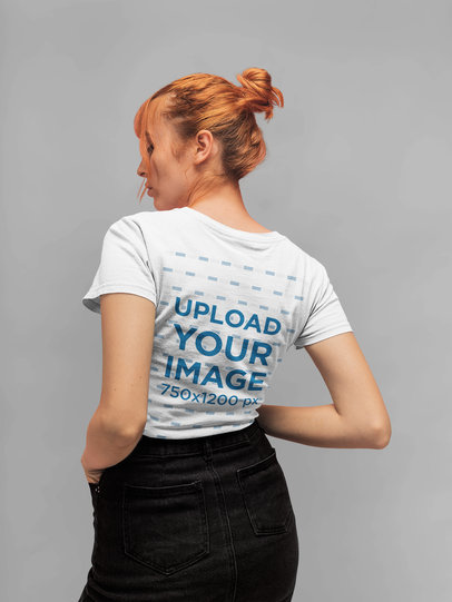 Back T-Shirt Mockup of a Red Haired Girl with a Hair Bun Standing in a Studio 20854