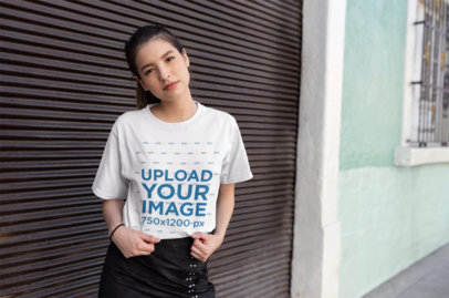 Mockup of a Trendy Girl Showing off Her Tee in an Urban Scenario 25779
