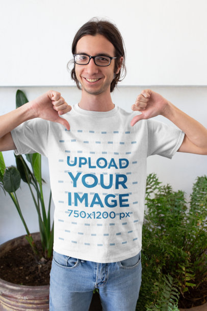 Mockup of a Happy Customer with Glasses Pointing His Own T-Shirt 26224