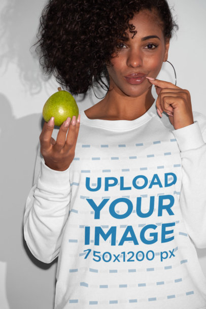 Sweatshirt Mockup of a Woman Posing with a Fruit in Her Hand 21909