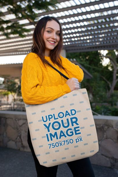 Mockup of a Pretty Woman Carrying a Tote Bag on Her Shoulder 24884