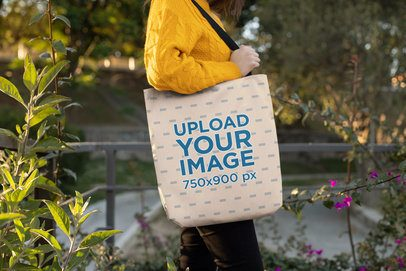 Tote Bag Mockup Featuring a Woman Posing in a Natural Environment 24888