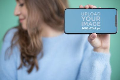 Mockup of an iPhone XS Max Being Hold by a Girly Girl 25369