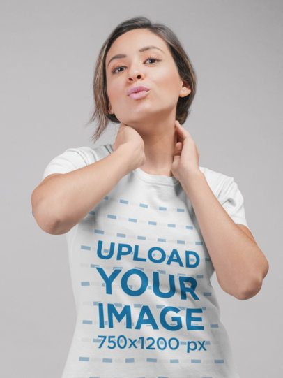 Mockup Featuring a Woman Wearing a Round Neck Tshirt While at a Studio 22338