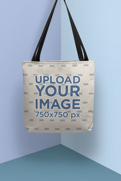 Mockup of a Tote Bag Hanging in a Colorful Setting 25161