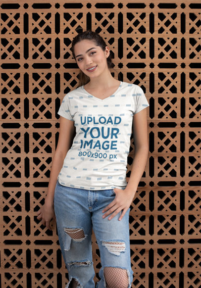 Mockup of a Girl Posing with a V-Neck T-Shirt Against a Patterned Wall 24935