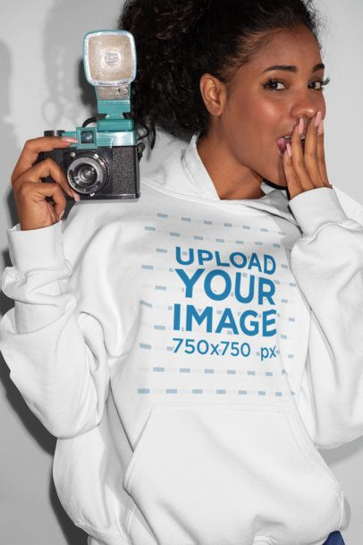 Hoodie Mockup Featuring a Girl Posing With a Camera 21914